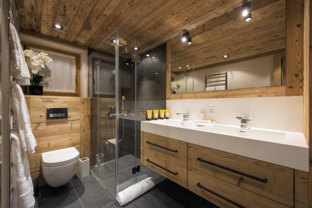 En suite shower room in Chalet Sirocco at The Alpine Estate in Verbier