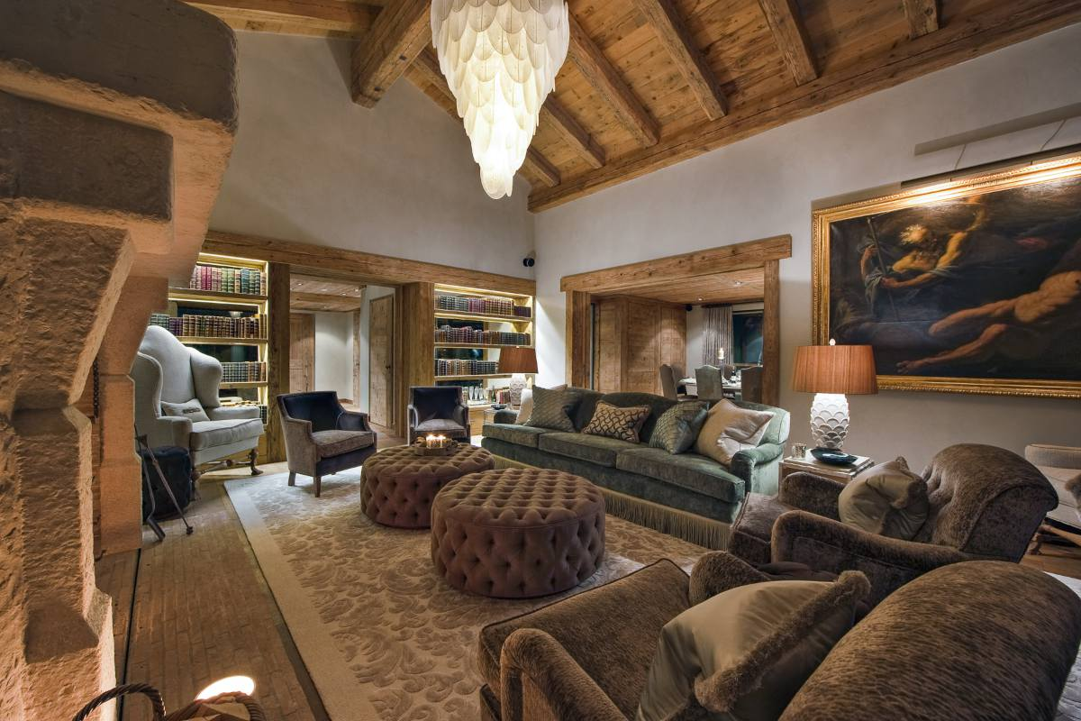 First floor living room with library corner in Chalet Norte at The Alpine Estate in Verbier