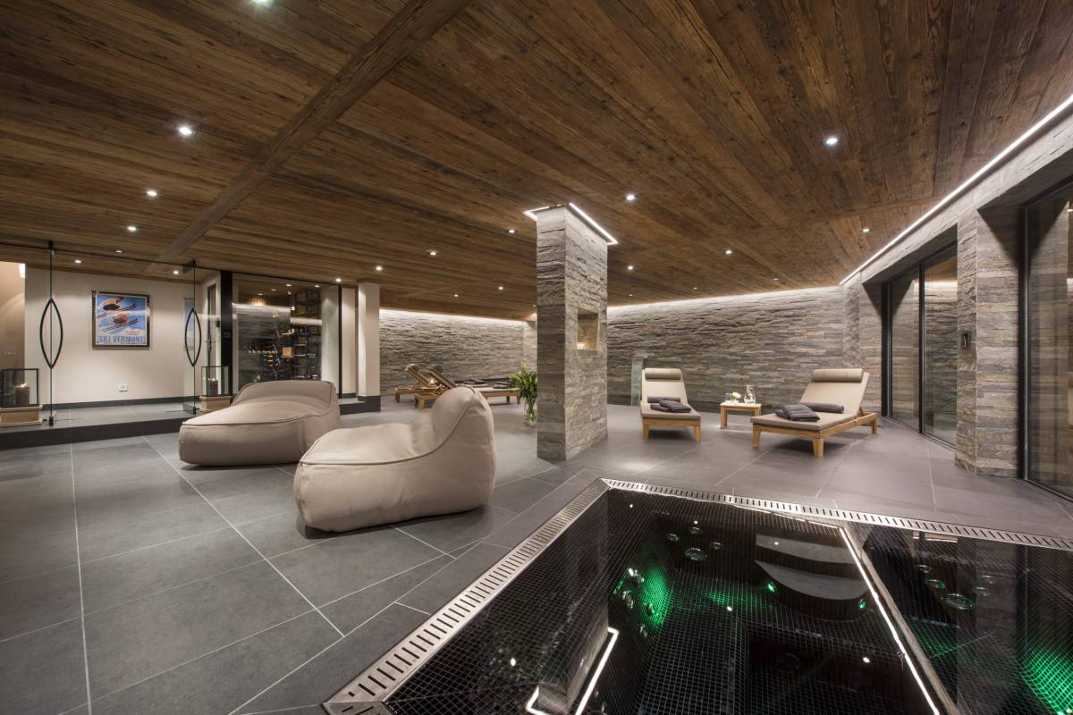 Indoor hot tub and relaxation area at Chalet Sirocco at The Alpine Estate in Verbier