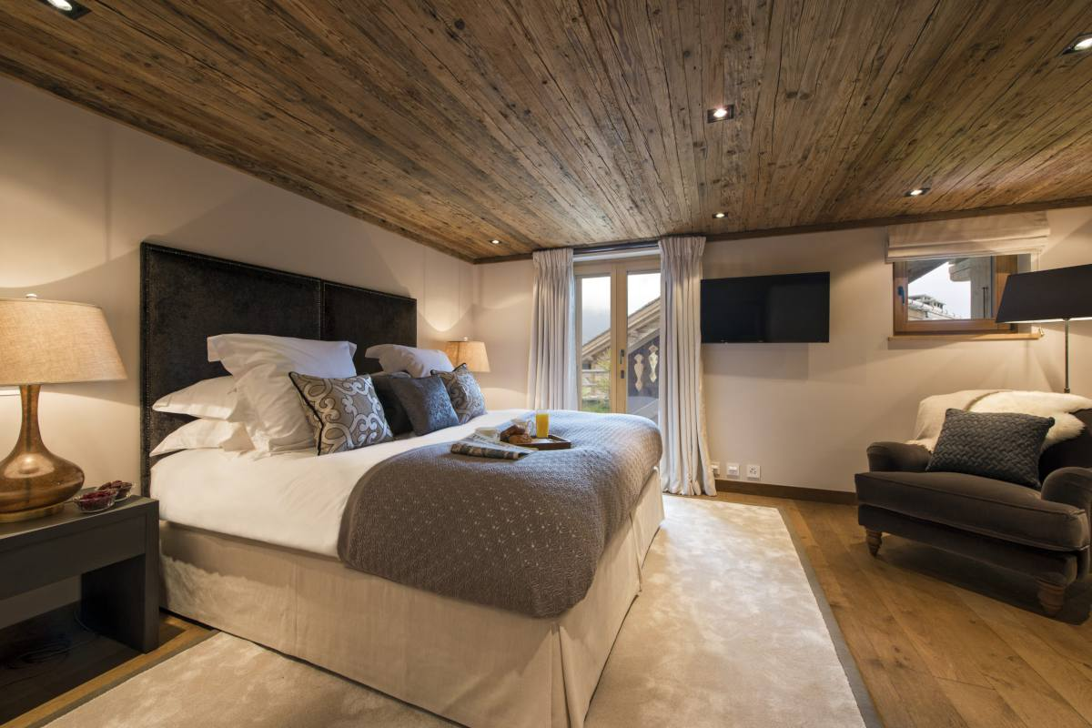 Master bedroom in Chalet Sirocco at The Alpine Estate in Verbier