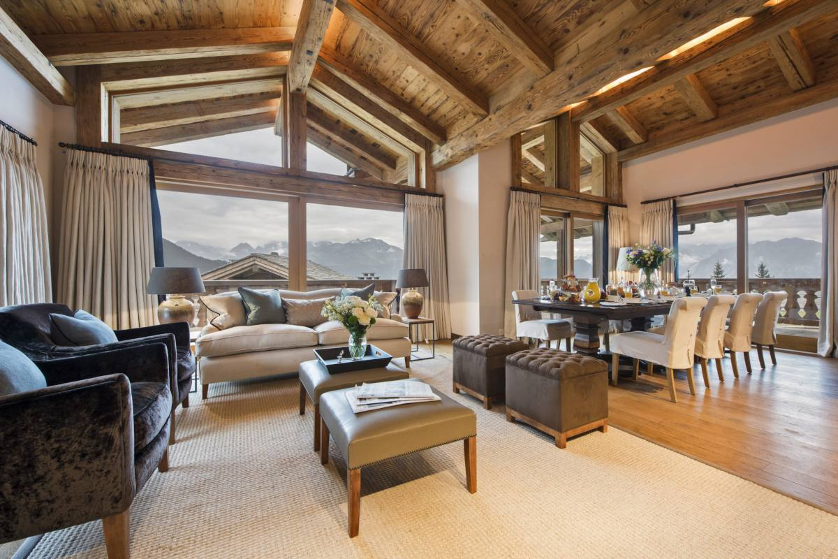 Open-plan living area in Chalet Sirocco at The Alpine Estate in Verbier