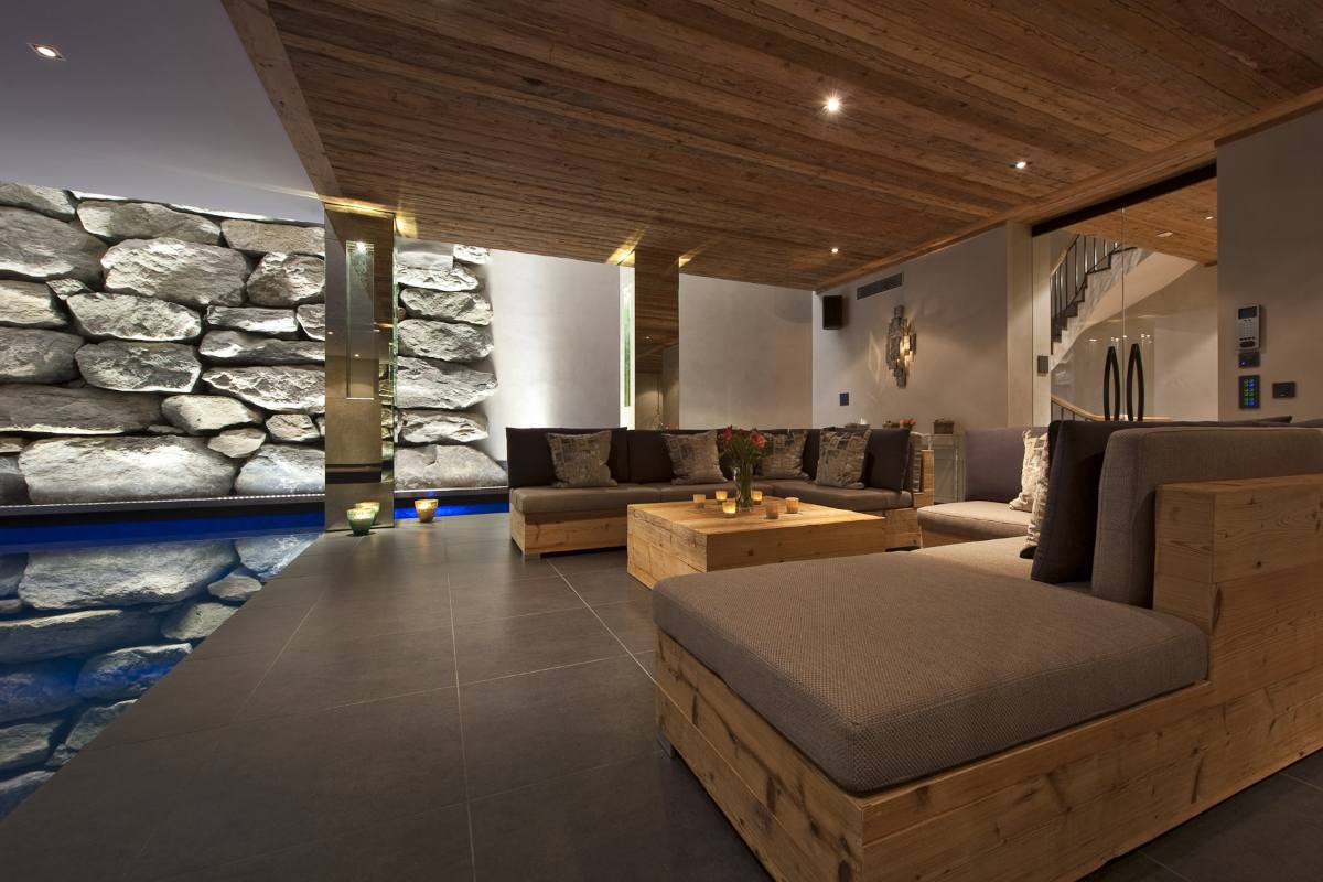 Spa with poolside lounge at The Alpine Estate in Verbier