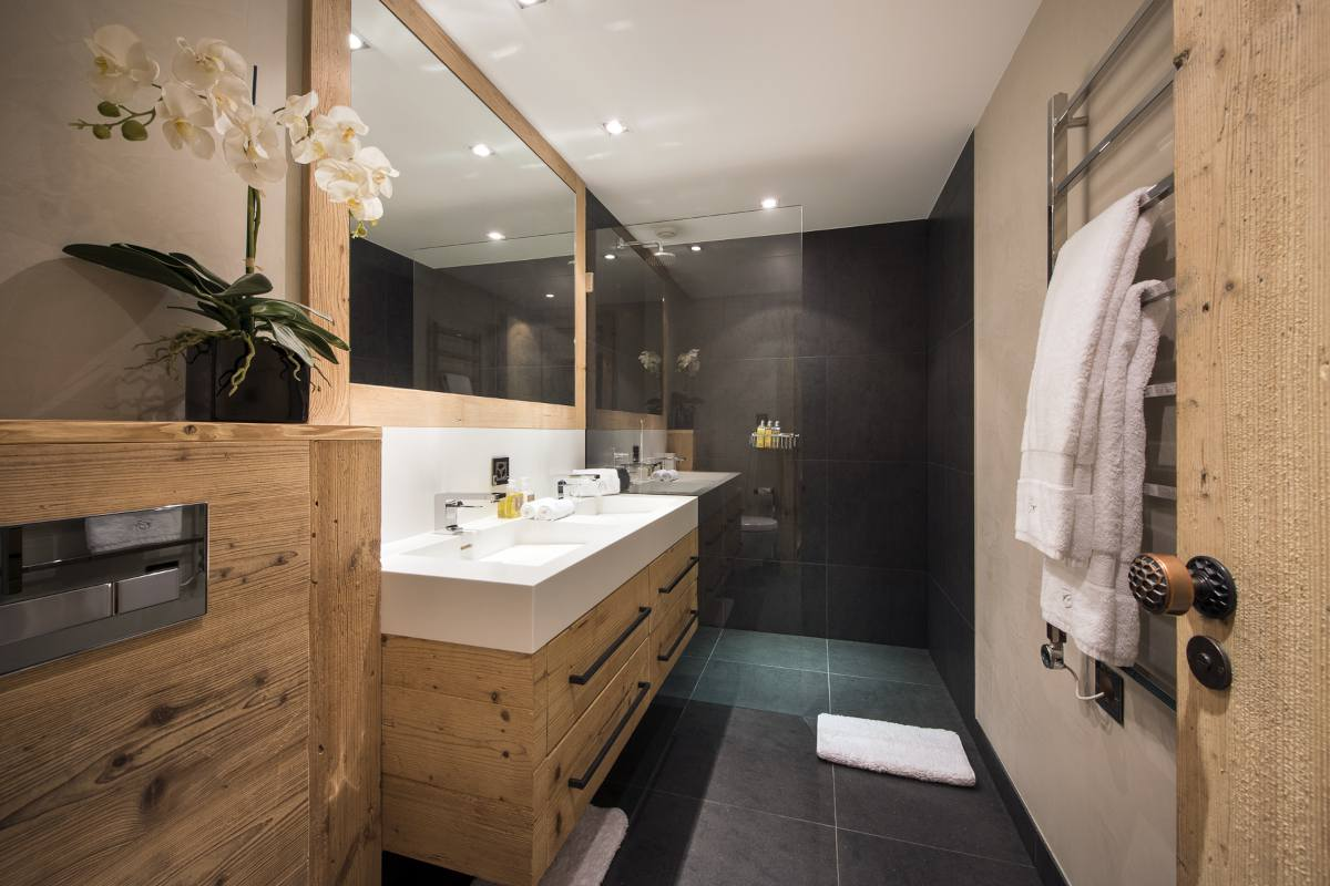 En suite shower room in the apartment in Chalet Norte at The Alpine Estate in Verbier