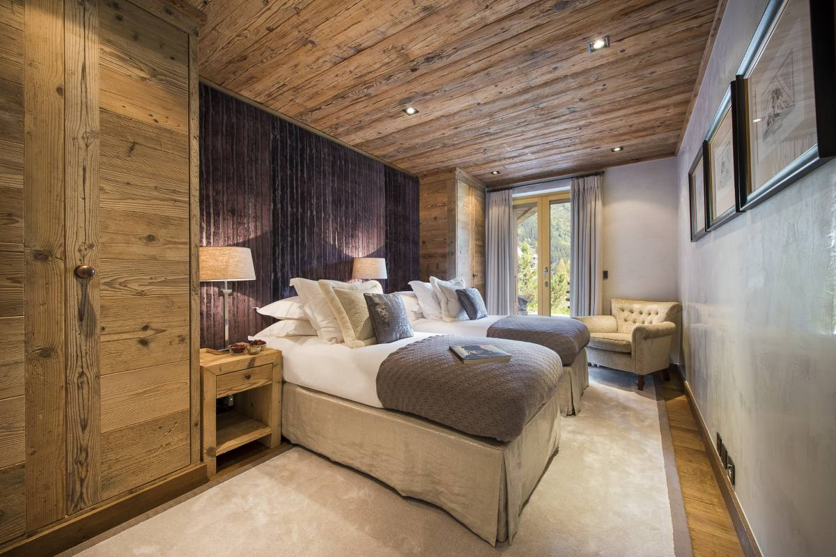 Twin bedroom with terrace access in Chalet Norte at The Alpine Estate in Verbier