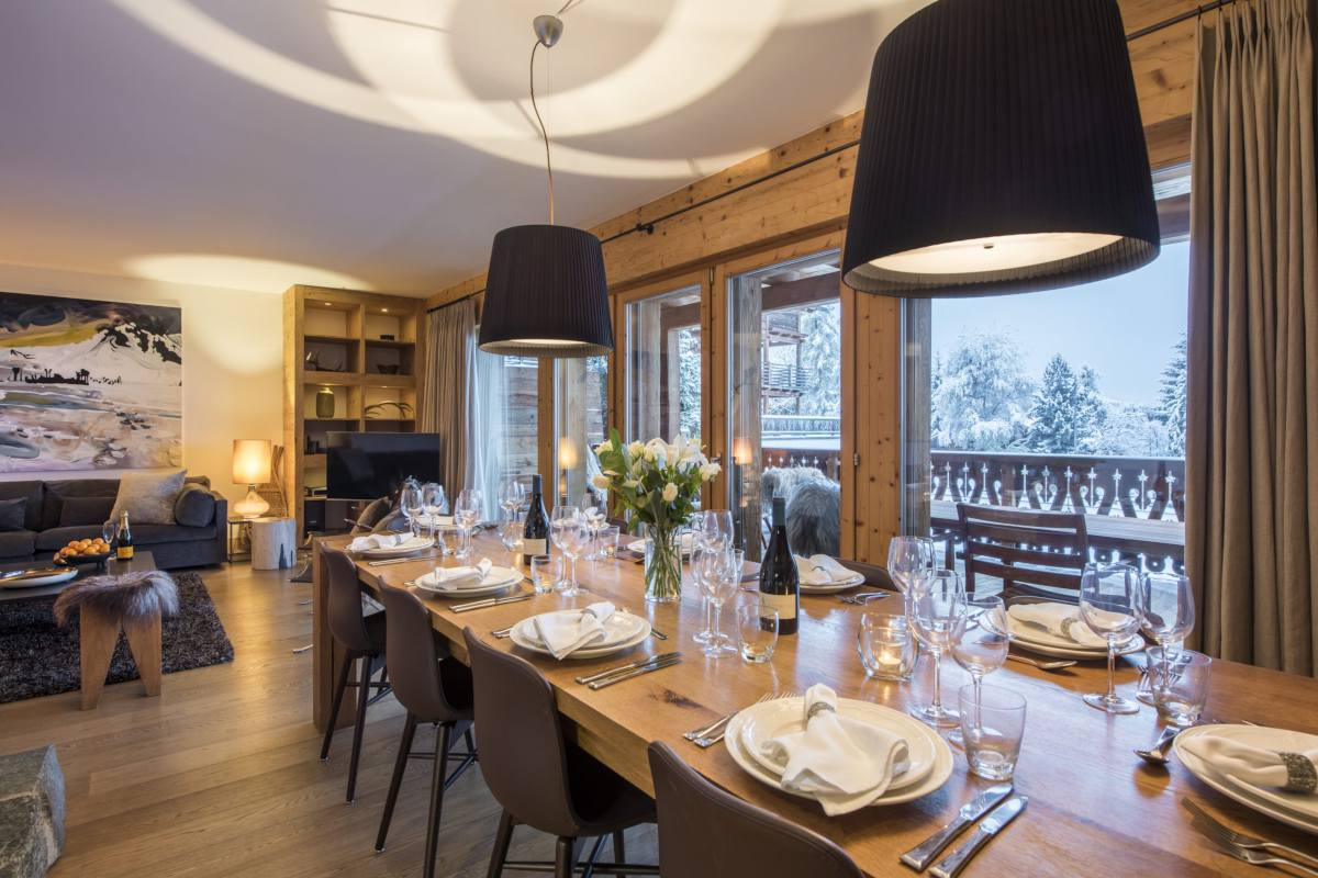 Dining area with balcony access at Apartment Victoria 111 in Verbier