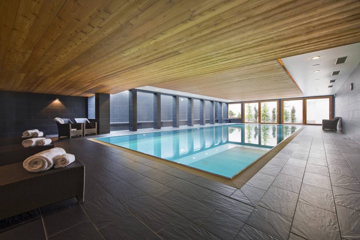 Shared indoor swimming pool at Apartment Victoria 111 in Verbier