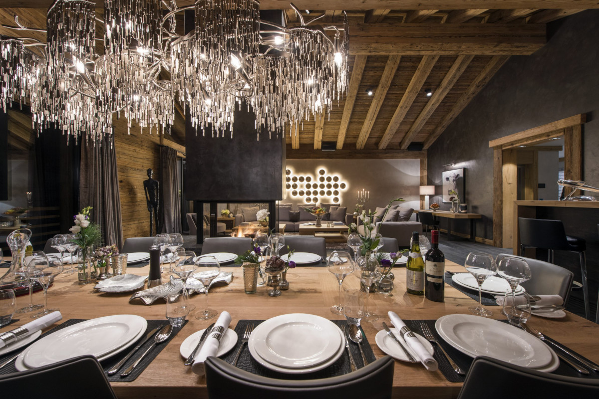 Dining table set for evening entertainment at Chalet Aconcagua in Zermatt