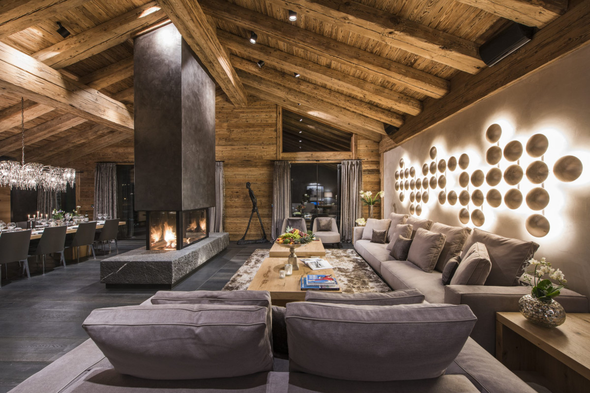 Lounge with open fire at Chalet Aconcagua in Zermatt