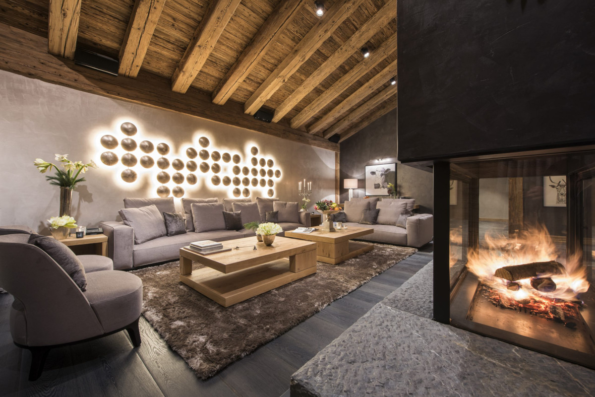 Lounge and open fire at Chalet Aconcagua in Zermatt