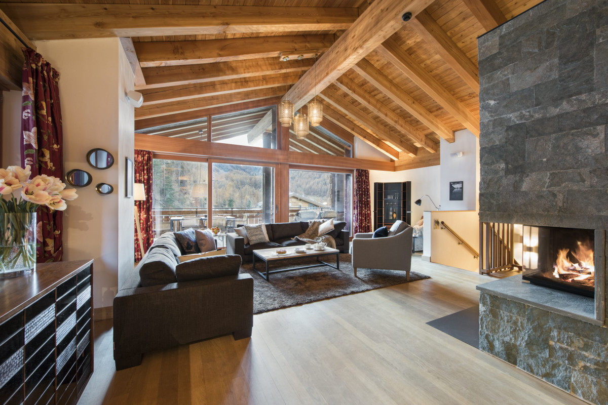 Open fire and living room at Apartment Alex in Zermatt
