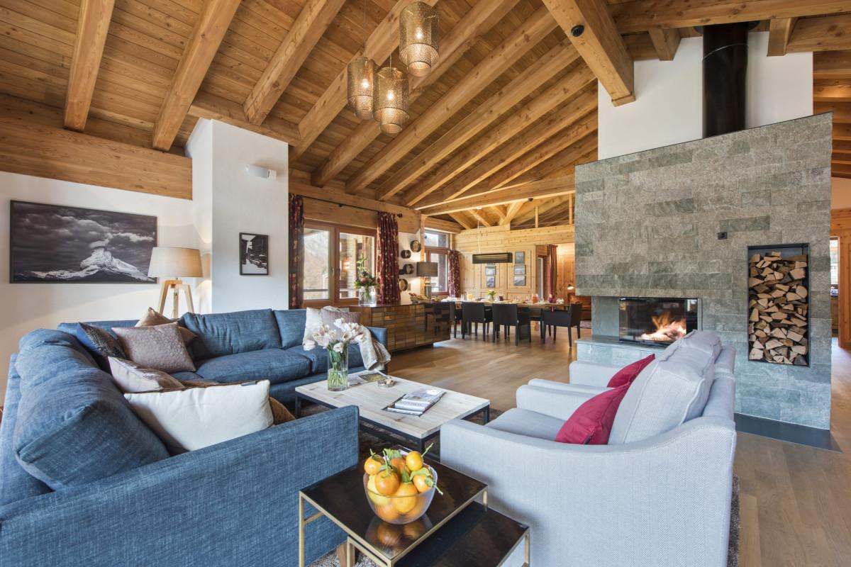 Lounge with open fire at Apartment Alex in Zermatt