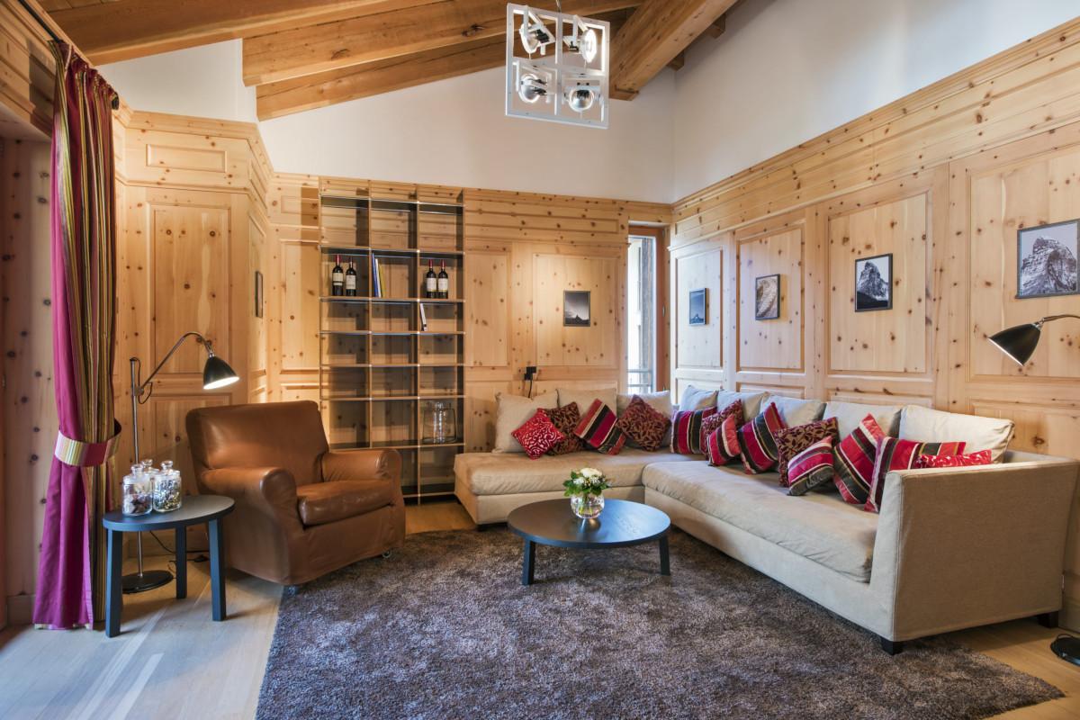 Living room and television snug at Apartment Alex in Zermatt