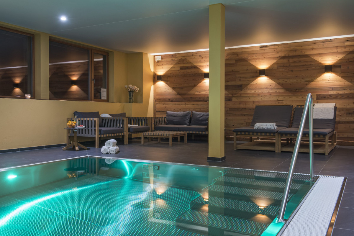 Swimming pool and relaxation area in the spa at Apartment Alex in Zermatt