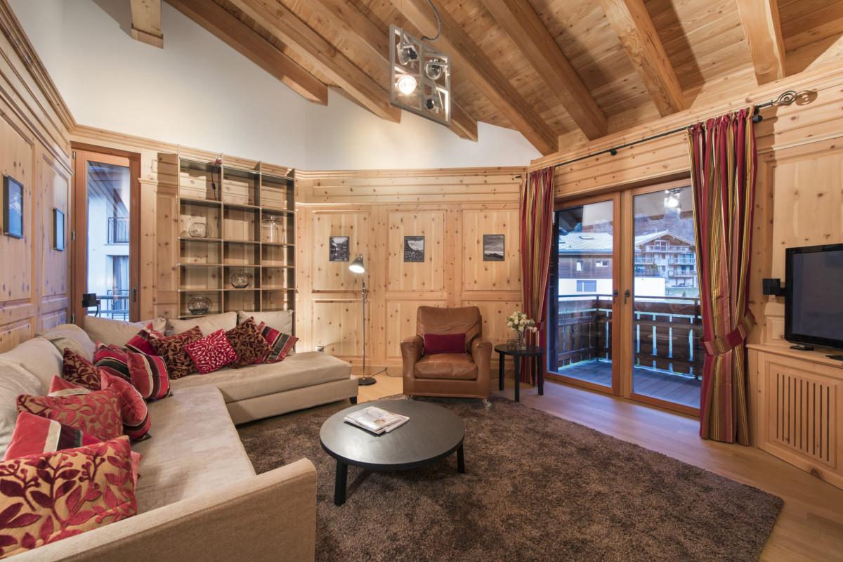 Television and living room at Apartment Alex in Zermatt