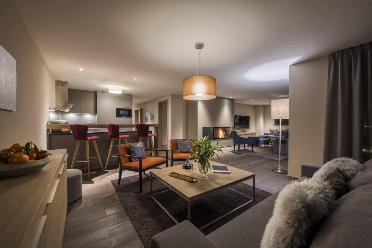 Open-plan living area at night at Christiania Apartment 7 in Zermatt