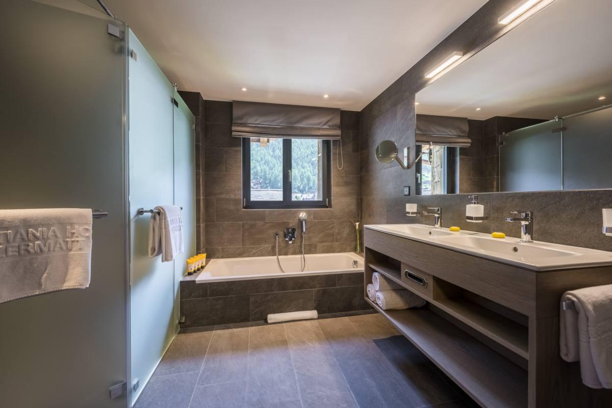 En suite bathroom at Christiania Penthouse in Zermatt
