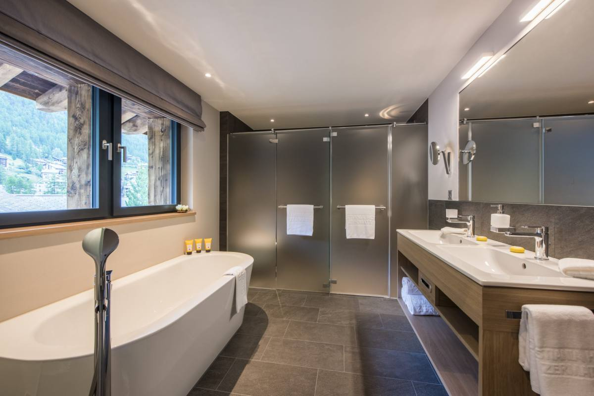 Freestanding bathtub in en suite bathroom at Christiania Penthouse in Zermatt