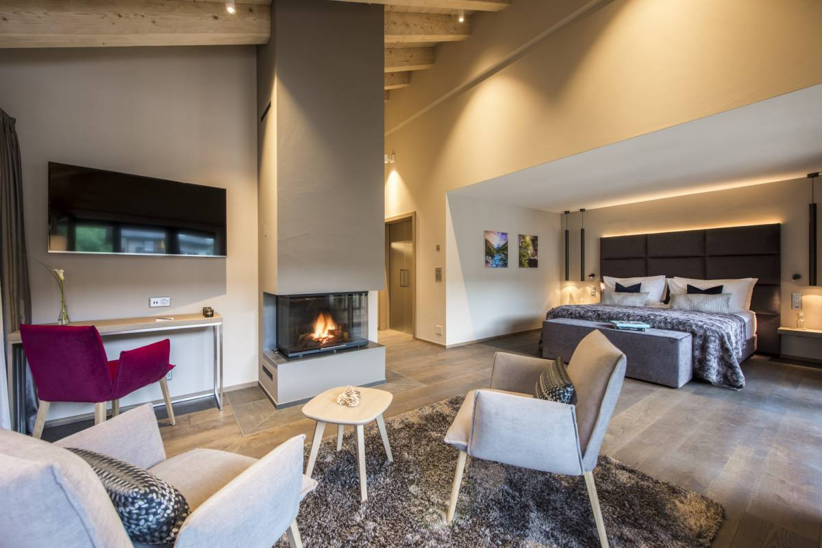 Fireplace and office area in master bedroom at Christiania Penthouse in Zermatt