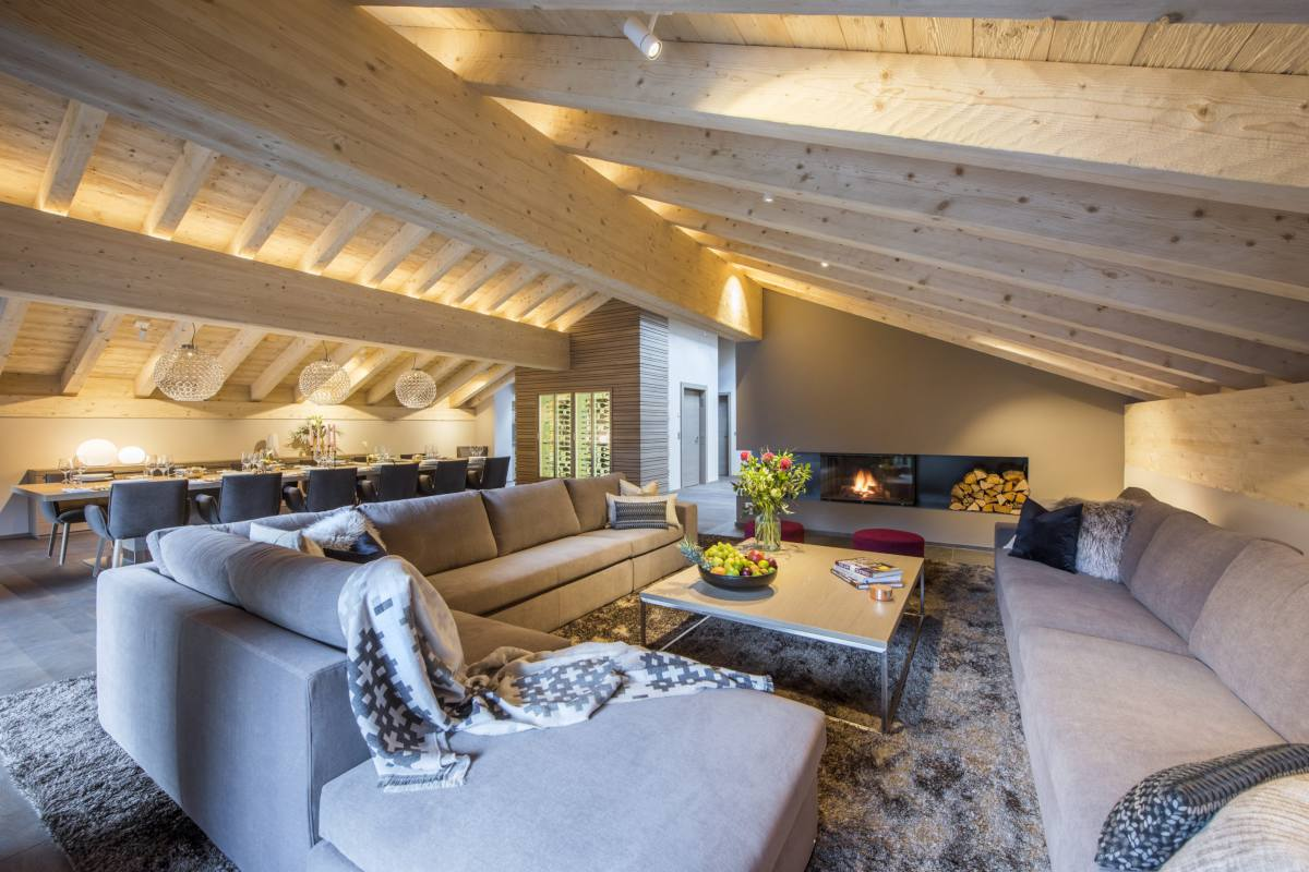 Sitting area with modern fireplace at Christiania Penthouse in Zermatt