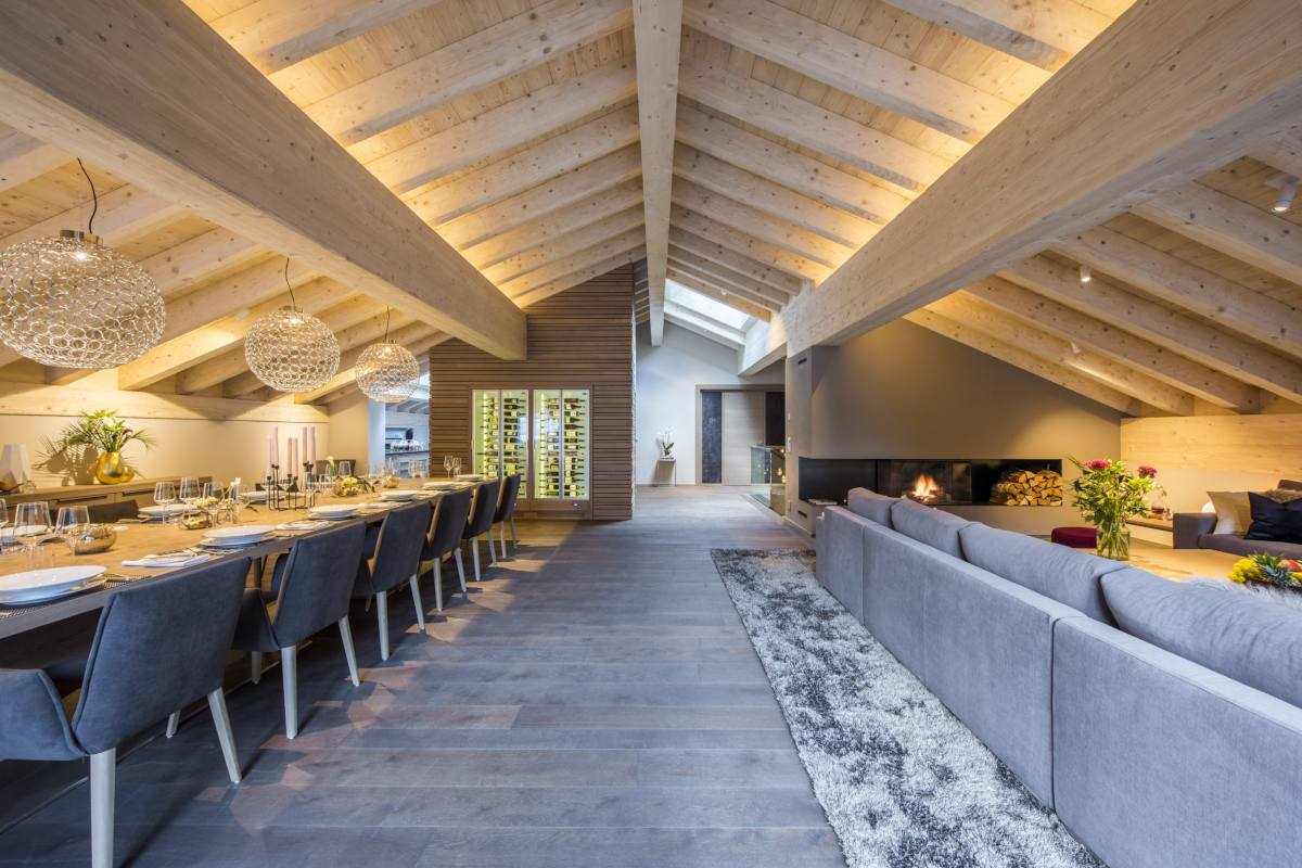 Open-plan living area with wine cellar at Christiania Penthouse in Zermatt