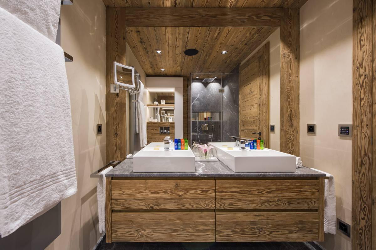 En suite shower room with double sinks at Chalet Elbrus in Zermatt