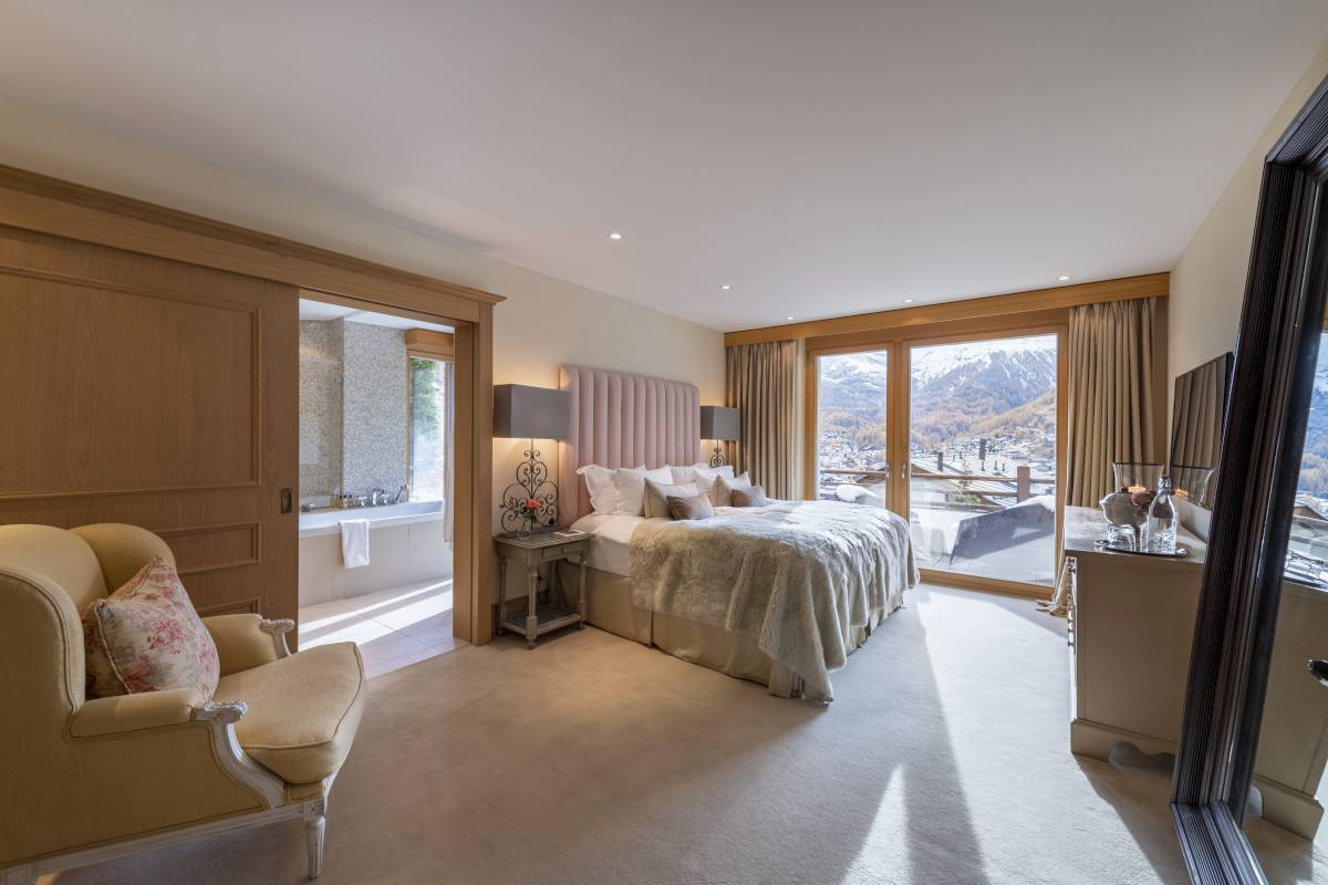 Aglea master bedroom with private balcony at Chalet Grace in Zermatt