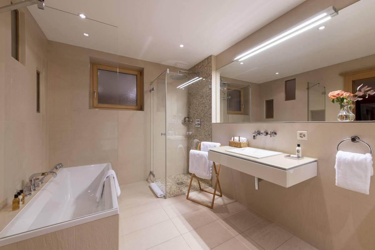Euphrosyne en suite bathroom with separate shower at Chalet Grace in Zermatt