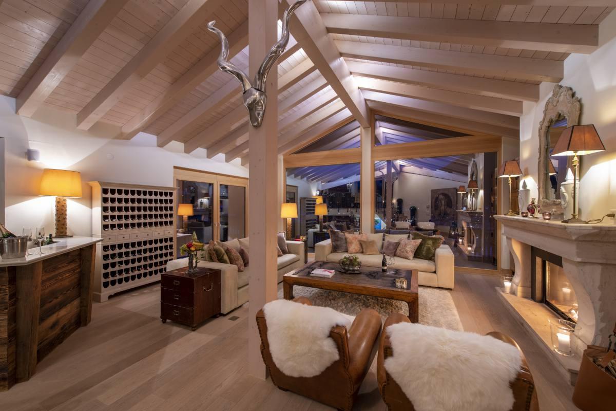 Living room at night at Chalet Grace in Zermatt