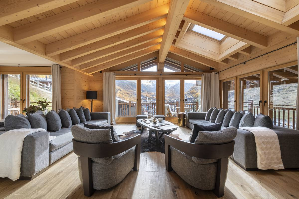Living room with mountain views at Chalet Maurice in Zermatt