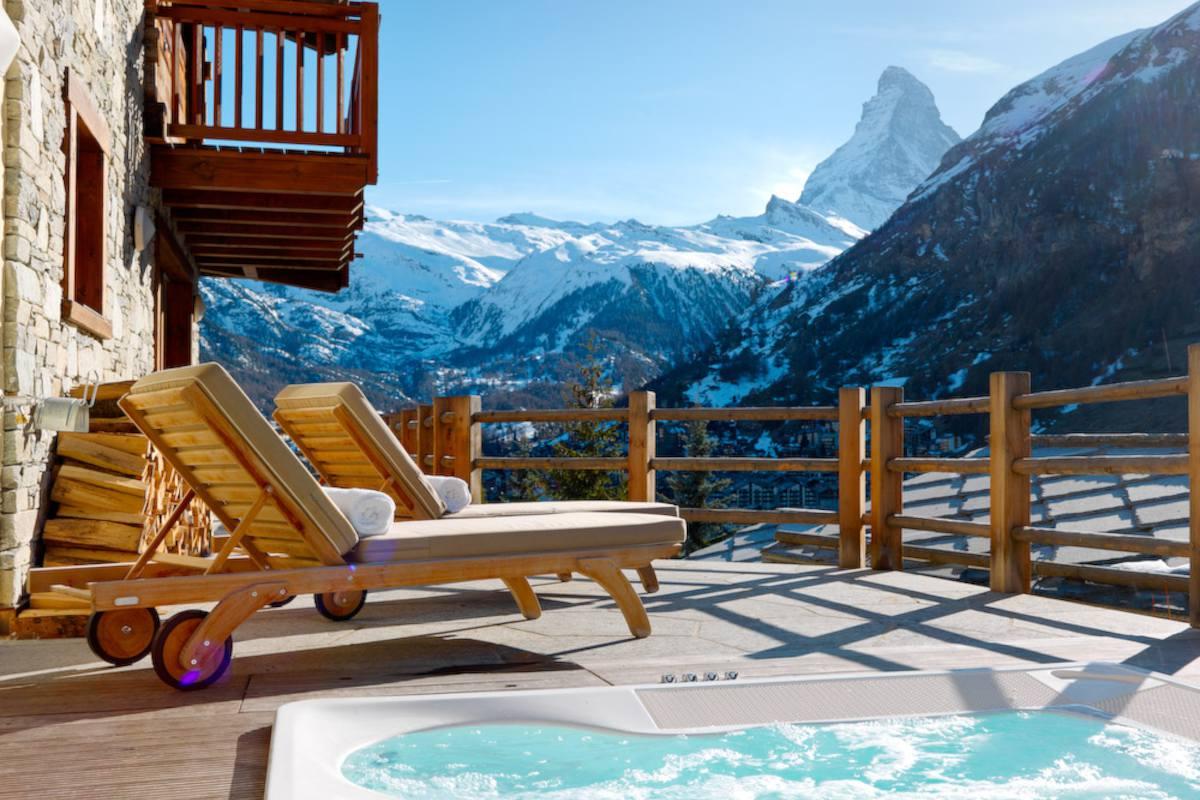 Terrace with outdoor hot tub and Matterhorn views at Chalet Maurice in Zermatt