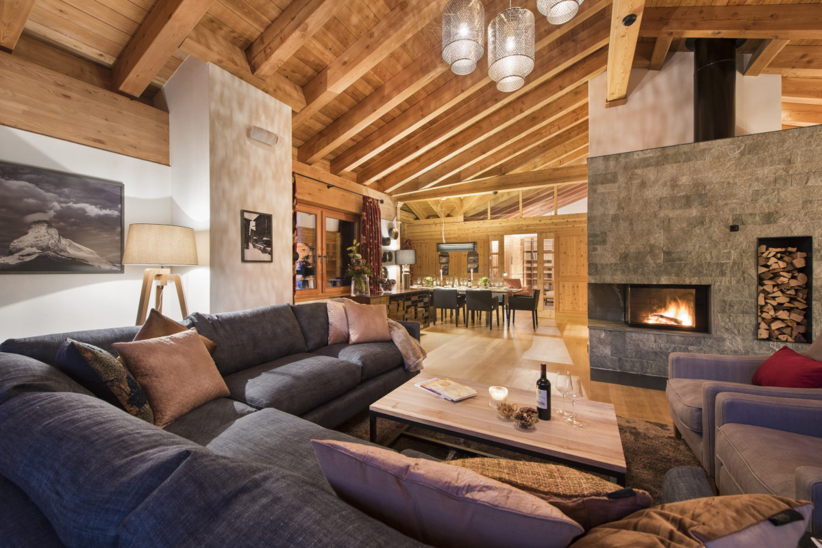 Upstairs lounge and open fire at Chalet Shalimar in Zermatt