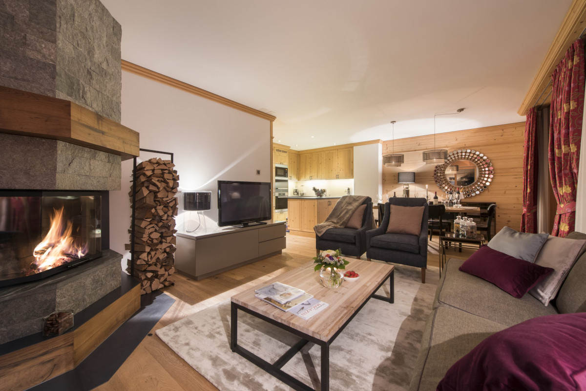 Open fire and lounge downstairs at Chalet Shalimar in Zermatt