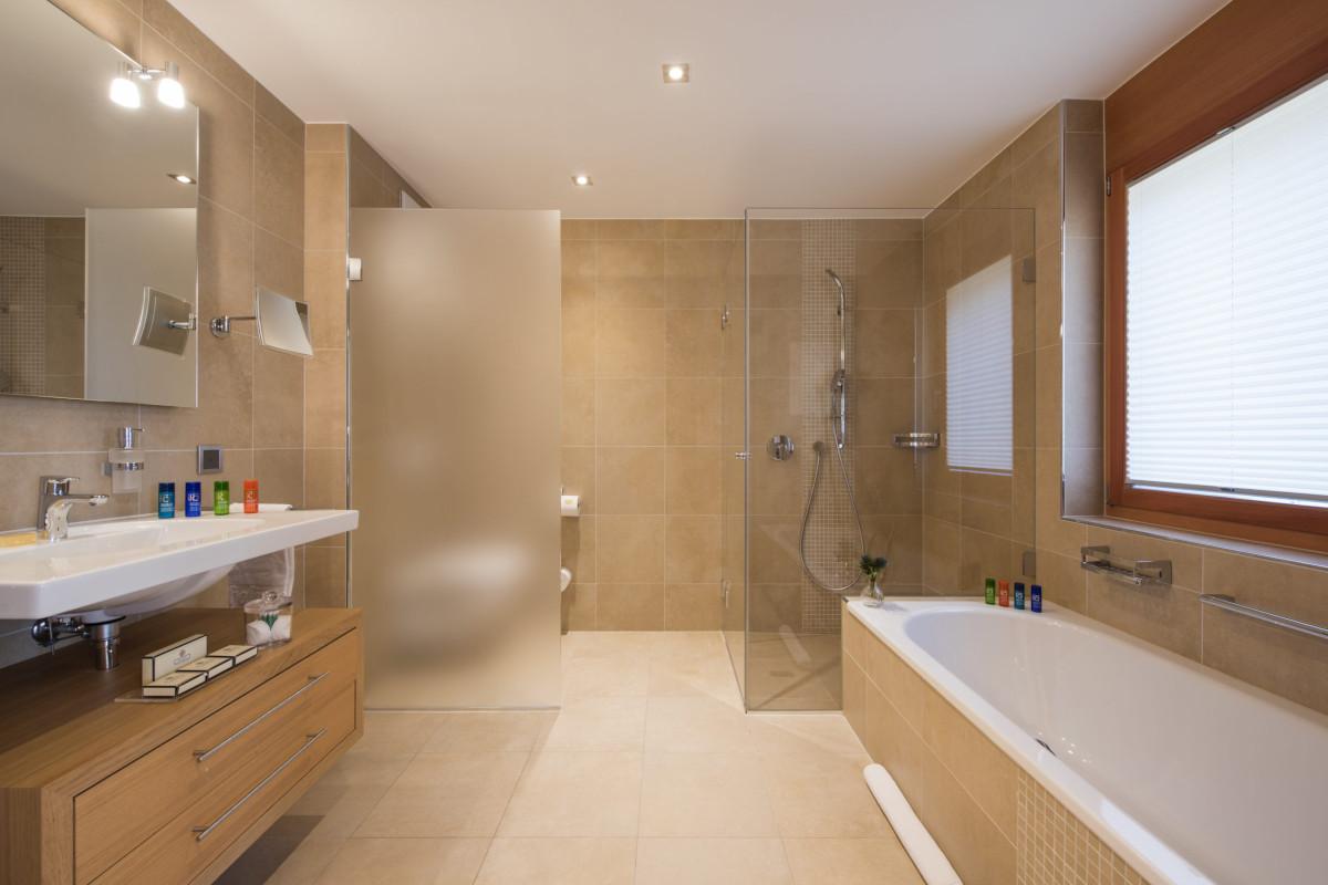 Ensuite bathroom with bath tub ad shower at Chalet Shalimar in Zermatt