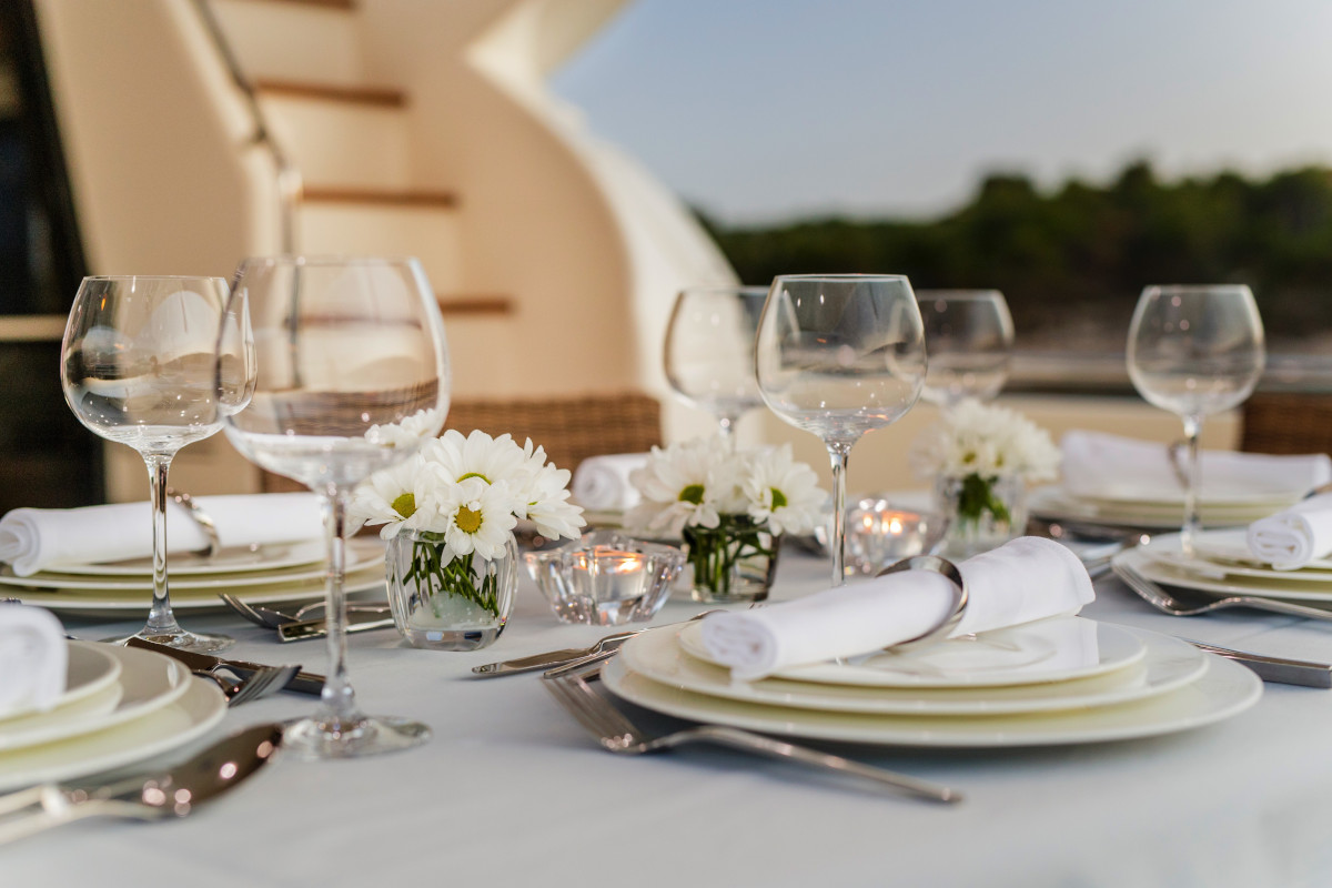 Aft deck table set for evening dining on M/Y Orlando L