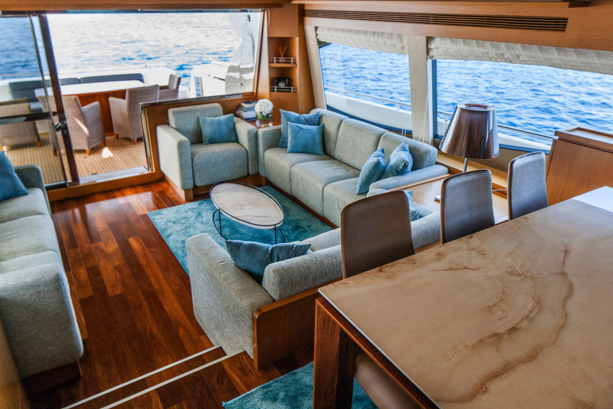 Dining table looking down on stylish saloon on M/Y Orlando L