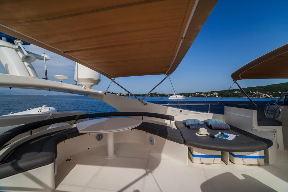 Seating under bimini shade on M/Y Orlando L cruising Croatia
