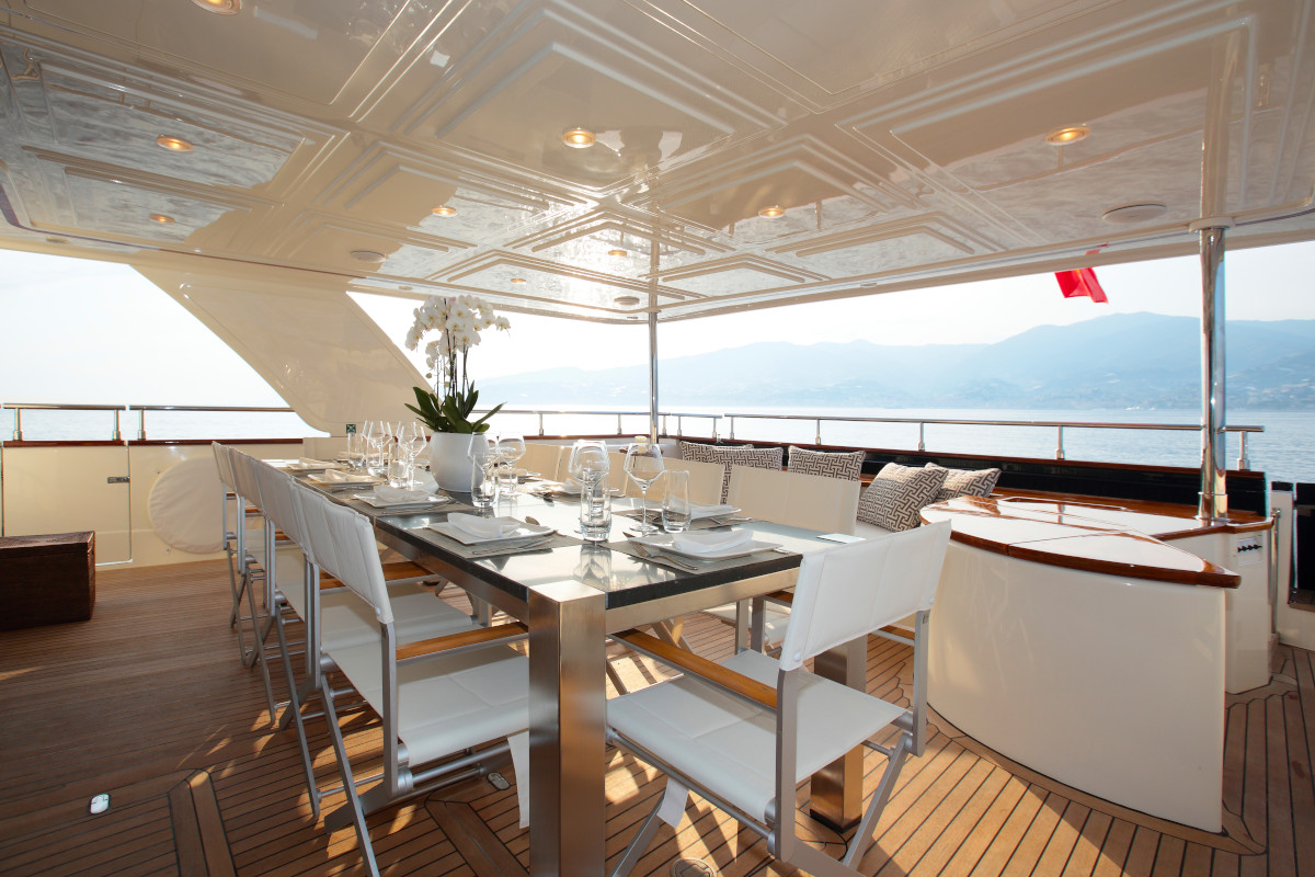 M/Y Lady Soul aft deck dining with comfortable relaxation space