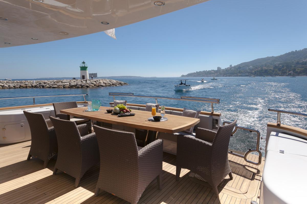 M/Y Olga I aft deck dining with views of Port Vauban in Antibes