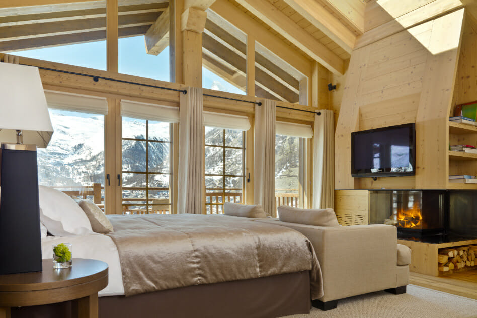 Master bedroom with open fire and views at Chalet Maurice, Zermatt