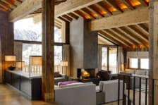 The lounge with open fire Chalet Les Anges, Zermatt.