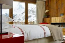 Master bedroom suite with view of the Matterhorn in Chalet Les Anges, Zermatt
