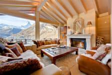 Living room with open fire and view of the Matterhorn Chalet Grace, Zermatt