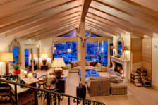 Lounge room with open fireplace and view of the Matterhorn, Chalet Grace Zermatt