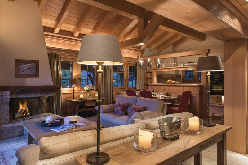 Lounge room with open fire Chalet Ivouette verbier